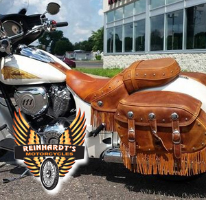 Photo of an Indian Motorcycle with Beautiful Brown Leather Custom Bags and Reinhardts logo